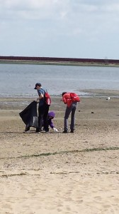 Volunteers Picking Up Trash at Jamaica Bay's North Channel Beach © Adriana Palmer